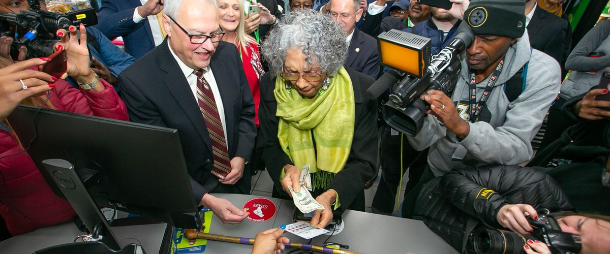 Alyce Clark buying her first scratch-off ticket as sales opened up in Mississippi